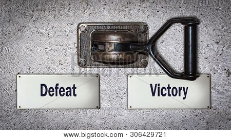 Wall Switch the Direction Way to Victory versus Defeat stock photo