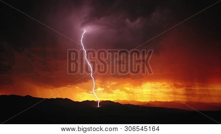 Lightning during a thunderstorm on a sunset background stock photo