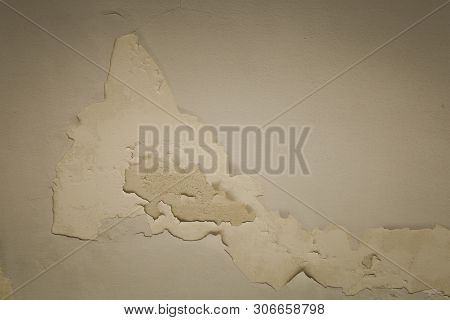Old wall aged by the passage of time in an abandoned place stock photo