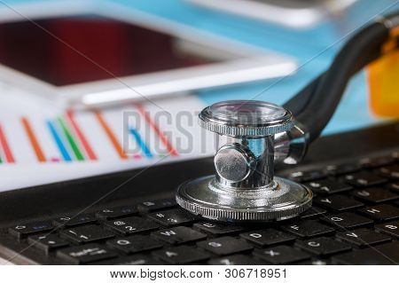 Computer data analysis stethoscope over a laptop computer keyboard medicine labarotory used digital pro tablet stock photo