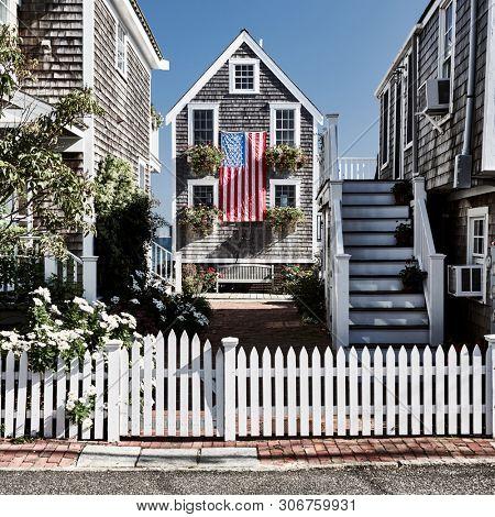 United States flag at suburban neighborhood. Provincetown, Cape Cod, Massachusetts, USA.