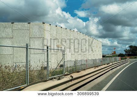A brick wall as part of a highway construction to bypass an Australian country town and improve traffic flow stock photo