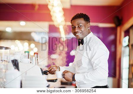 African american bartender or barman at bar stock photo