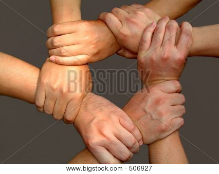 strong mans' arms making unbrakeable strong business team work stock photo