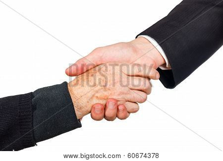 Young businessman shaking hand with elderly woman stock photo