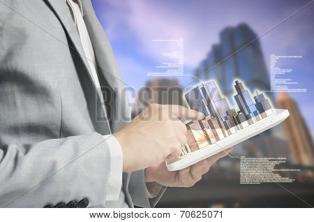 Young Business man using Tablet PC to present the Building as Building business concept stock photo