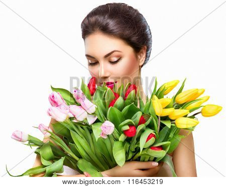 Beauty Woman with Spring Flower bouquet. Beautiful girl with a Bunch of colorful Tulip flowers. Happ