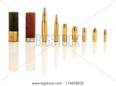 Image containing both shotgun shells rifle and handgun ammunation in different calibers. Included are 12 guage .308 or 7.62mm NATO .223 or 5.56mm NATO .45 .38 special 9mm hollow point 9mm .22 long rifle. stock photo
