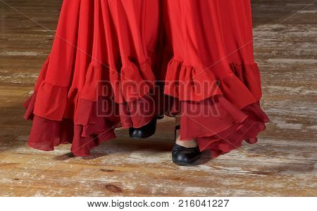 Legs of woman dancer, flamenco dancer, legs of flamenco dance close up, woman in red dress, dance passion