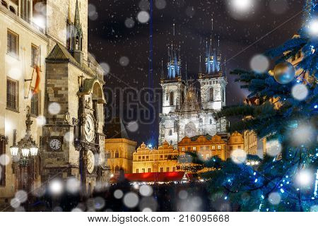 Old Town Hall with astronomical clock, Town Square with Christmas tree and fairy tale Church of our Lady Tyn in the magical city of Prague at snowy night, Czech Republic stock photo