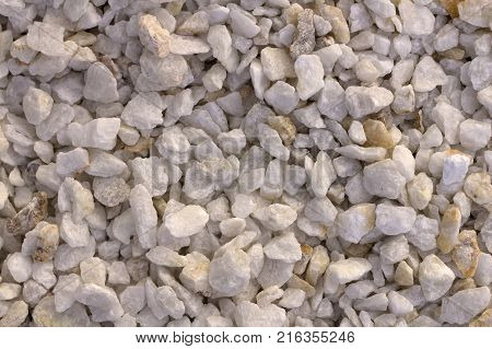 Texture, pattern, background. marble chips for landscaping pebbles close-up samples, marble pebbles, a hard crystalline metamorphic form of limestone, stock photo