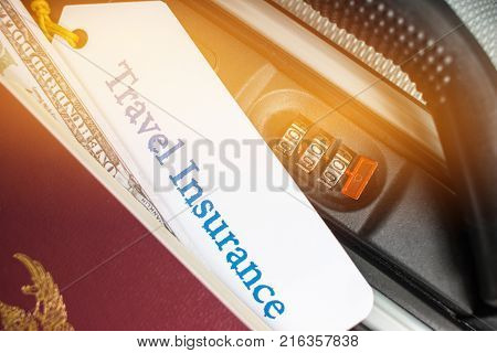 Travel Insurance tag on suitcase near numeric combination lockpassport and US Dollar. Travel Insurance is intended cover medical expensescover lost luggage flight cancellation or accident stock photo