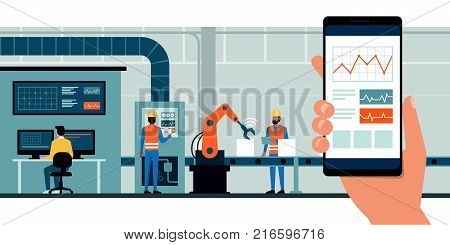 Industry 4.0 monitoring app on a smartphone and smart automated production line with workers and robots on the background stock photo