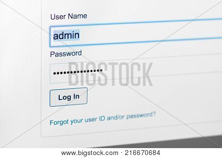 Filled login and hidden by dots password at login screen on the website stock photo