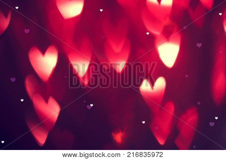 Valentine's Day Background. Holiday Blinking Abstract Valentine Background with Glowing Hearts. Hear