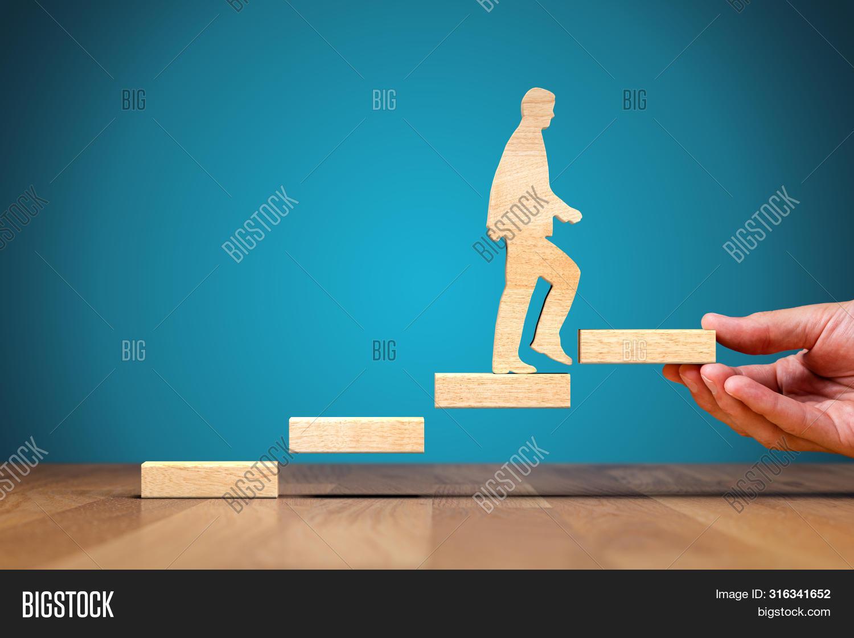 HR,advisor,aspiration,asset,businessman,career,challenge,coach,coaching,concept,consultant,development,employment,executive,growth,human,improving,male,man,management,manager,mentor,motivate,motivation,personal,personnel,potential,progress,resources,rise,self-confidence,self-development,senior,stairs,success,supervise,supervisor,wood