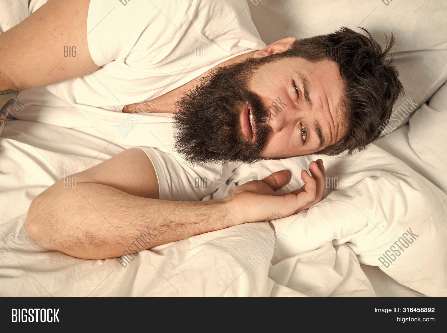 adult,awake,background,beard,bearded,bed,caucasian,concept,drowsy,early,exhausted,face,get,guy,handsome,healthy,hipster,hours,insomnia,lazy,leisure,macho,man,morning,mustache,nap,pillow,problems,relax,sheets,sleep,sleepy,time,tired,unhappy,unshaven,up,wake,waking,wellbeing,white,woke