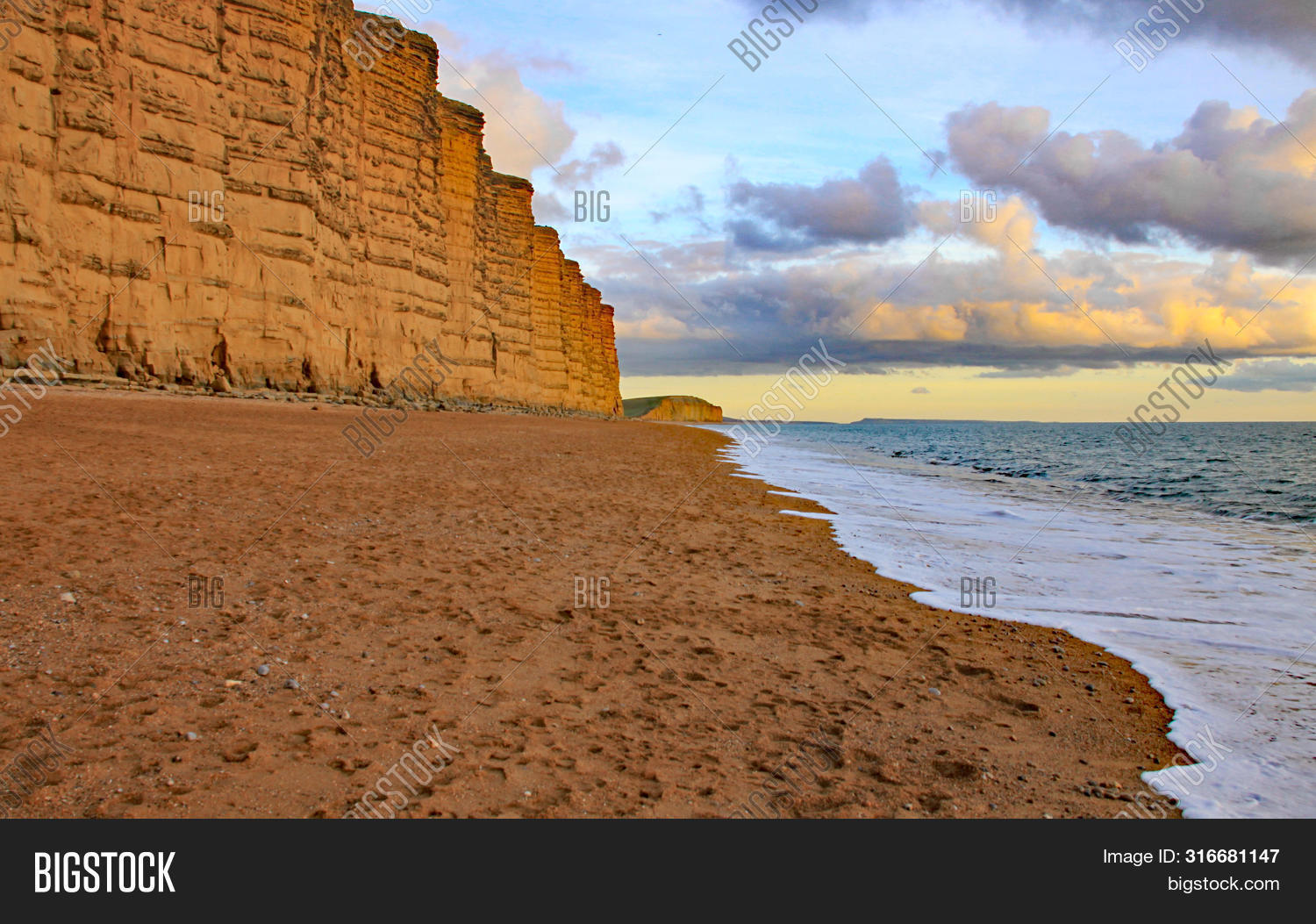 The Sandstone Cliffs At West Bay In Dorset, England. This Is Part Of The Jurassic Coast Which Runs F