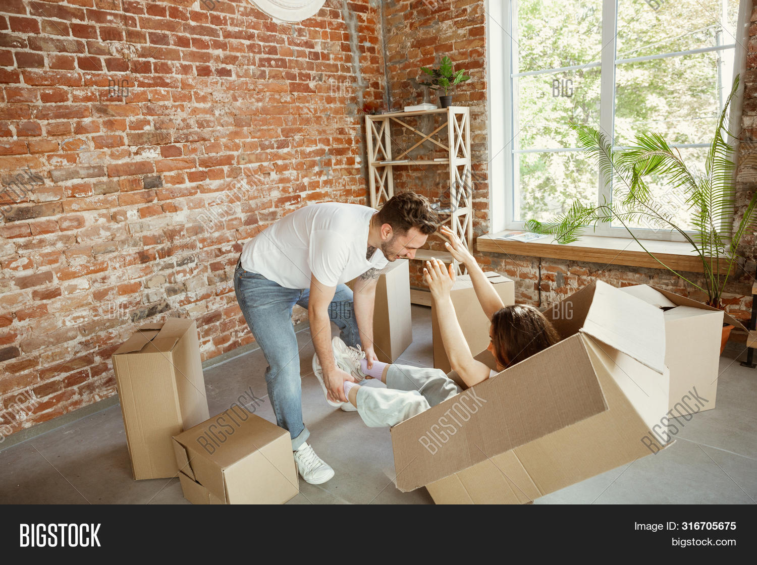 apartment,background,beautiful,beginnings,box,boxes,cardboard,carton,casual,cheerful,container,couple,day,daylight,domestic,female,floor,happy,home,homeowner,house,husband,indoors,laughing,lifestyle,love,male,man,men,move,moving,new,owner,package,packing,pause,people,photographing,portrait,real,relaxing,rent,sitting,smile,together,two,unpacking,urban,wife,woman