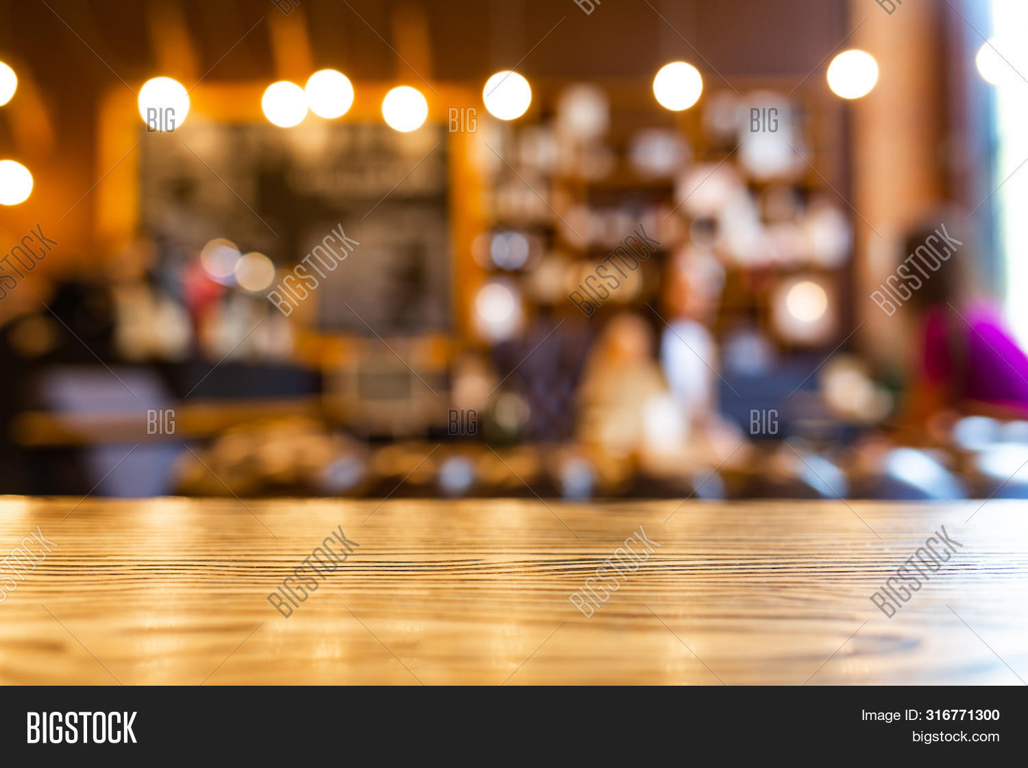Wooden Top Table With Blurred Of Coffee Shop Background. Mockup Wooden Desk For Display Or Montage Y