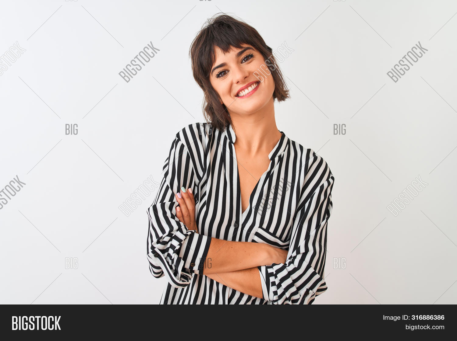 Young beautiful woman wearing striped shirt standing over isolated white background happy face smili