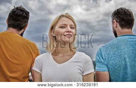 Girl stand in front two faceless men. Best traits of great boyfriend. How to pick better boyfriend. Girl thinking whom she going ask dating. Everything you need to know about choosing right guy stock photo
