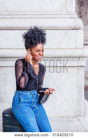 Young African American Woman With Afro Hairstyle, Wearing Mesh Sheer Long Sleeve Shirt Blouse, Blue