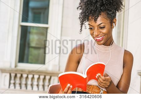 Young Happy African American Female College Student With Afro Hairstyle Sitting By Vintage Style Off
