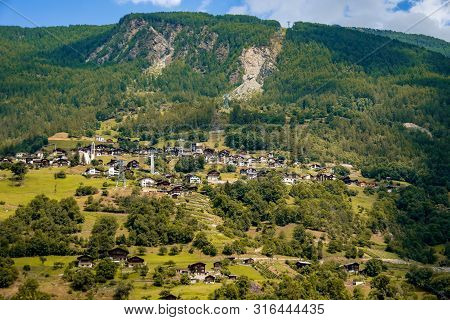Amazing view of the hillside village and green slopes of the Swiss Alps. Colorful summer view of village. Idyllic outdoor scene in Switzerland, Europe. stock photo