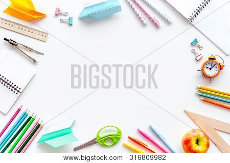 Education Concept With Stationery Of Student With Notebook, Pens, Clock Frame On White Background To