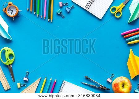 Education Concept With Stationery Of Student With Notebook, Pens, Clock On Blue Background Top View