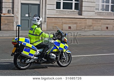 British motorcycle policeman in full florescent uniform stock photo