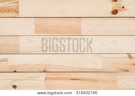 Wood Glued timber plank background. Wooden construction glued laminated timber in the wall of the house. Glued beams texture. Natural pattern pine wood background. stock photo