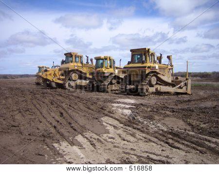 heavy construction equipment on excavation site stock photo