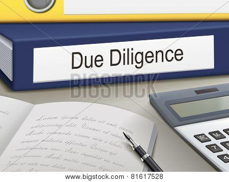 due diligence binders on the office table stock photo