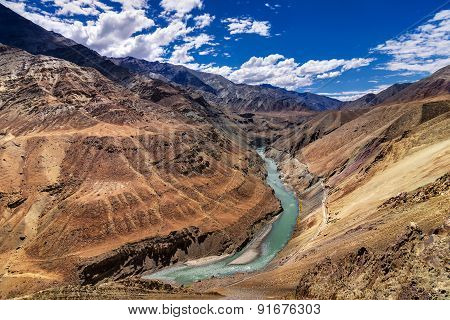 Beautiful Zanskar river flowing through rocks of Ladakh Jammu and Kashmir India natural landscape and scenic view of waterbody riverbank aerial view. stock photo