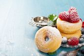 Morning breakfast with smaller than normal doughnuts and berries