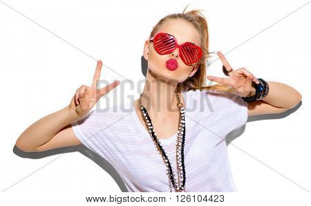 Fashion Model girl isolated over white background. Beauty stylish blonde woman posing in fashionable