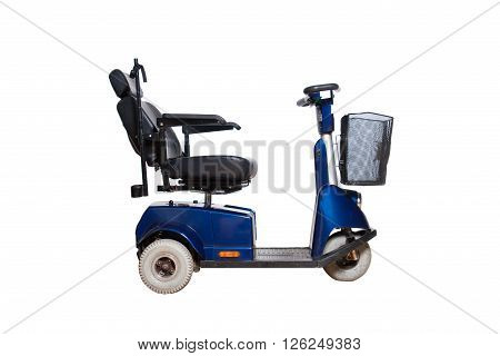 3 wheel motorised wheelchair with basket for disabled people isolated stock photo