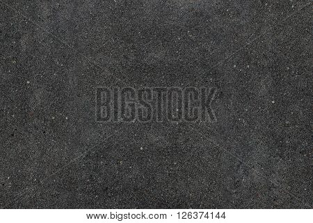 Real asphalt texture background. Coloured dark black asphalt pattern. Grainy street detail gray textured background. Best way show your design or illustration with this actual asphault photo texture.