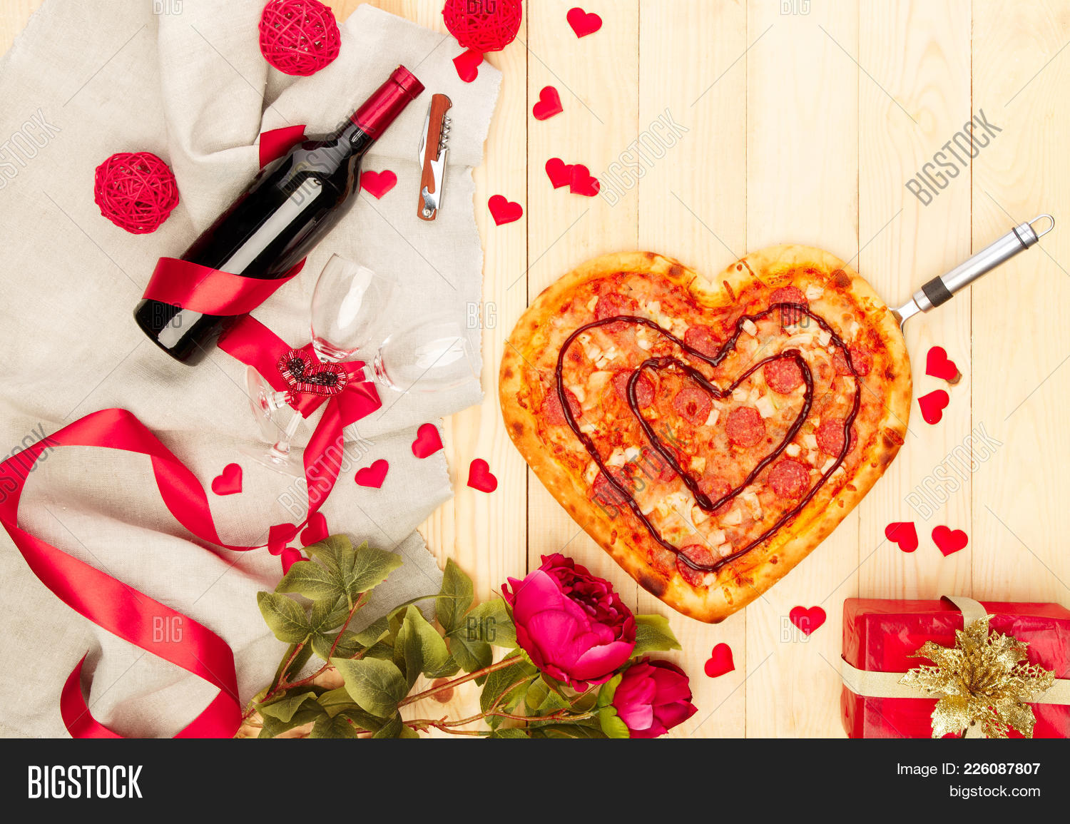 above,appointment,background,baked,board,bottle,brown,celebrate,cheese,closeup,concept,copyspace,corkscrew,cuisine,decor,delicious,dinner,drink,evening,flour,flower,food,gift,glass,heart,italian,italy,love,mozzarella,nutrition,pepper,pepperoni,pizza,red,ribbon,romance,romantic,rustic,shape,shaped,symbol,table,tasty,tomato,valentine,vegetable,wine,wood,wooden,yellow