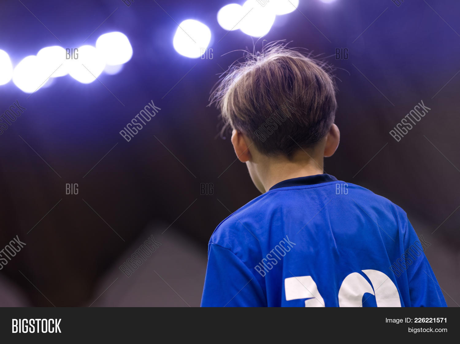 arena,background,beautiful,blue,boy,caucasian,child,childhood,concept,cute,education,expression,football,head,healthy,jersey,junior,jupiter,kid,lifestyle,lights,little,male,one,person,physical,play,player,portrait,pose,posing,pretty,profile,queue,satisfaction,school,shirt,single,small,soccer,sport,sporting,sportive,sportswear,sporty,stadium,standing,white,young,youth