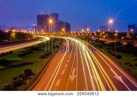 Hanoi cityscape at Thang Long multiple land highway at night. Focus on the highway stock photo