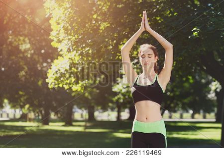 Woman outdoors, tree pose asana, crop. Fit girl balancing in vrksasana. Stretching, wellness, calmness, relax, healthy, active lifestyle concept stock photo