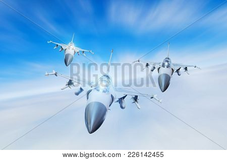 Military fighters jet three group aircraft at high speed, flying high in the sky stock photo