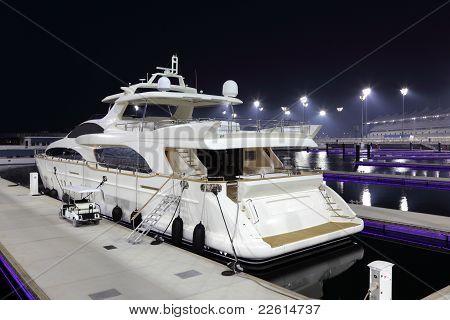 Luxury yacht in Yas Marina at night. Abu Dhabi United Arab Emirates stock photo