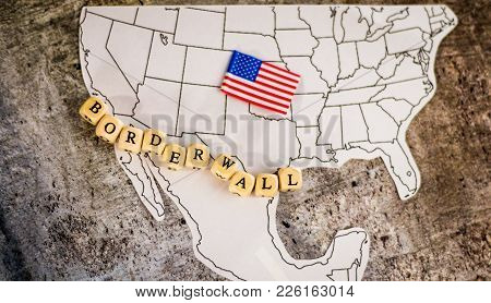 Border wall business concept with border wall letter blocks placed over the US and Mexico border stock photo