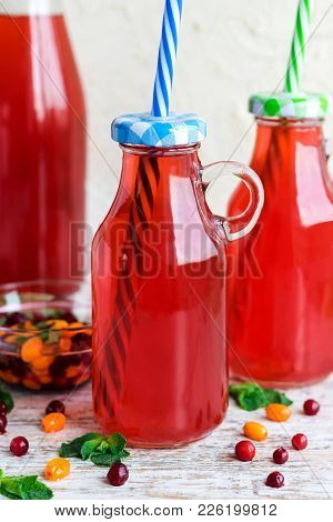 Traditional Russian drink - morse sea-buckthorn berries and cranberries stock photo