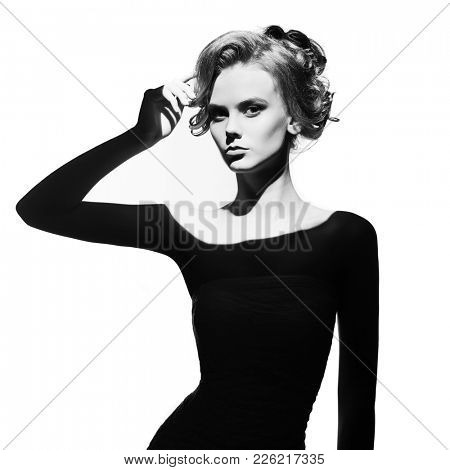 Black and white art fashion surrealistic portrait of beautiful woman with a beam of light on her face stock photo