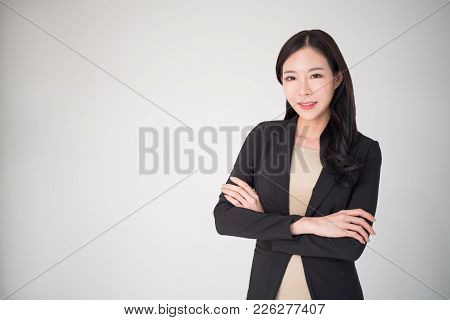 Asian business woman happy smiling isolated on white background. Beautiful, pretty, professional, happy, confident asian business woman concept. Business woman has important role in business nowadays stock photo